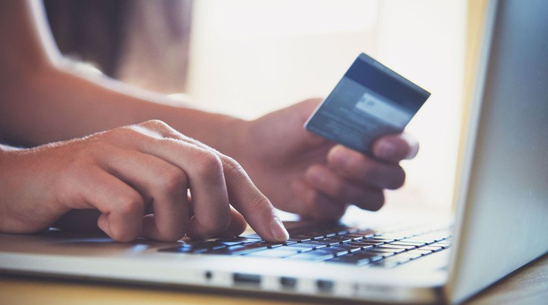 46650760 - hands holding credit card and using laptop. online shopping