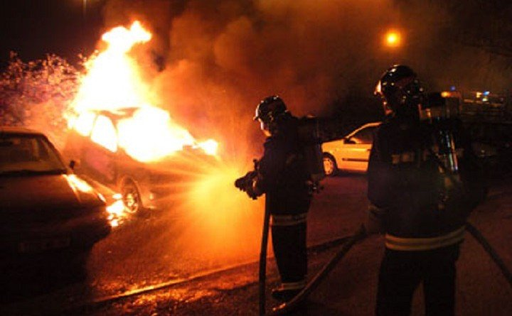Firemen try to extinguish a burning car in Villiers-le-Bel, a Paris suburb on February 18, 2008, after a major pre-dawn police operation in and around Villiers-le-Bel, targeting the suspected ringleaders of riots last year. Police arrested at least 33 people. Violence flared up in the area in November 2007 after two teenagers died in a motorbike crash with a police car. Nearly 1,000 elite forces took part in the operation, said sources close to the investigation. AFP PHOTO JEAN AYISSI